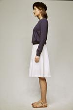 white skirt and navy pullover